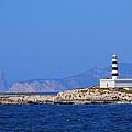 Lighthouse On Isla De Es Penjats by Karol Kozlowski