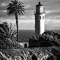 Lighthouse On The Bluff by Jerry Cowart