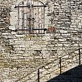 Limestone Wall With Door And Shadow by Jaak Nilson