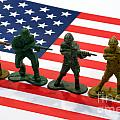 Line Of Toy Soldiers On American Flag Crisp Depth Of Field by Amy Cicconi