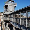 Lisbon Cityscape With Castle And Santa Justa Elevator by Luis Alvarenga