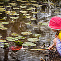 Little Girl Looking For Little Fish by James Woody
