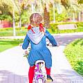 Little Girl On The Bicycle by Anna Om