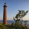 Little Sable Lighthouse By The Shore by Randall Nyhof