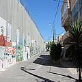 Living Next To Wall by Munir Alawi