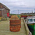 Lobster Fishing Baskets And Boats By A Dock In Forillon Np-qc by Ruth Hager