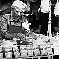Local Arab Man Measuring Out A Quantity Of Spice For Sale On Stall Of Spices At The Market In Nabeul Tunisia by Joe Fox