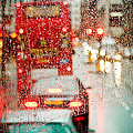 London Rain View To Red Bus Through Rainspecked Window by Raimond Klavins