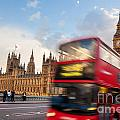 London The Uk Red Bus In Motion And Big Ben by Michal Bednarek