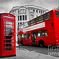 London Uk Red Phone Booth And Red Bus In Motion by Michal Bednarek