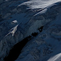 Lone Alpinist Silhouetted On Heavily by Jonathan Griffith