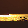 Lone Paddler At Sunset by J H Clery