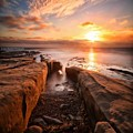 Long Exposure Sunset At A Rocky Reef In by Larry Marshall