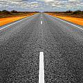 Long Straight Road With Gathering Storm Clouds by Colin and Linda McKie