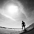 Longboarder Riding A Small Wave by Kyle Morris