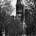 looking down Kurfurstendamm towards Kaiser Wilhelm Gedachtniskirche memorial church Berlin Germany by Joe Fox