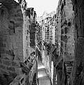 Looking Down On Internal Walkways From Upper Tier Of Old Roman Colloseum El Jem Tunisia Vertical by Joe Fox