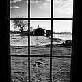 looking out through door window to snow covered scene in small rural village of Forget by Joe Fox