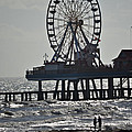 Lovers And A Surfer At Pleasure Pier by Allen Sheffield