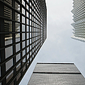 Low Angle View Of Skyscrapers Towering by Michael Interisano / Design Pics