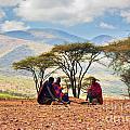 Maasai Men Sitting. Savannah Landscape In Tanzania by Michal Bednarek