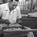 Making Puka Shell Necklaces by Underwood Archives
