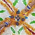 Making Rangoli With Flower Petals And Oil Lamps by Tim Gainey