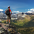 Male Hiker Standing On Top Of Mountain by Michael Interisano