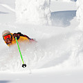 Male Skier Makes A Deep Powder Turn by Craig Moore