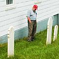 Man At Headstone by Boss Photographic
