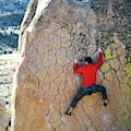 Man Bouldering On An Overhang by Corey Rich