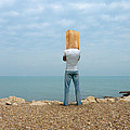 Man By The Sea With Bag On His Head by Jill Battaglia