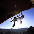 Man Climbing On An Overhang In Joshua by Corey Rich