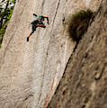 Man Falls While Climbing A Crack Route by Paolo Sartori