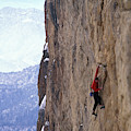 Man In A Red Shirt Lead Climbing by Corey Rich