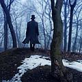 Man In Top Hat Walking Through Foggy Woods by Jill Battaglia