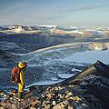 Man Overlooking Olympus Range Antarctica by Colin Monteath