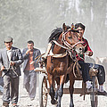 Man Riding A Carriage At Kashgar Sunday Market China by Matteo Colombo