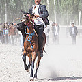 Man Riding A Horse At Kashgar Sunday Market China by Matteo Colombo