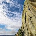 Man Rock Climbing At Devils Tower by Bennett Barthelemy