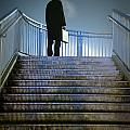 Man With Case At Night On Stairs by Lee Avison