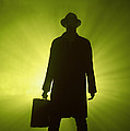Man With Case In Green Light by Lee Avison