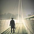 Man With Case On Bridge by Lee Avison