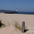 Manistee Harbor Lighthouse From Beach by Ronald Grogan