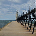 Manistee Lighthouse And Walkway by Susan Wyman