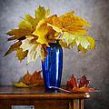 Maple Leaves In Blue Vase  by Nikolay Panov