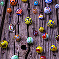 Marbles On Wood by Garry Gay