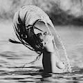 Marisa Berenson Flipping Her Hair In Water by Arnaud de Rosnay
