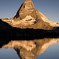 Matterhorn Reflected In Riffelsee Lake  by Ingo Arndt