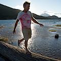 Mature Man Balances Along Log by Philip & Karen Smith / TFA